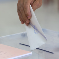 КС РФ допустил возможность переноса даты выборов в Госдуму