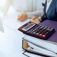 Реорганизация в форме слияния: начисляем страховые взносы
